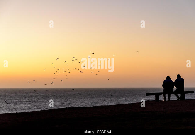 Chile, Two people on beach at sunset - Stock Image