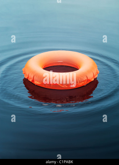 Inflatable ring floating on water - Stock-Bilder