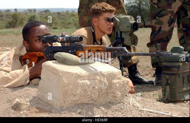 Ethiopian Pvt. Abebaw Damte fires a Dragunov sniper rifle at a shooting range outside Camp Ramrod, Ethiopia, Sept. - Stock Image