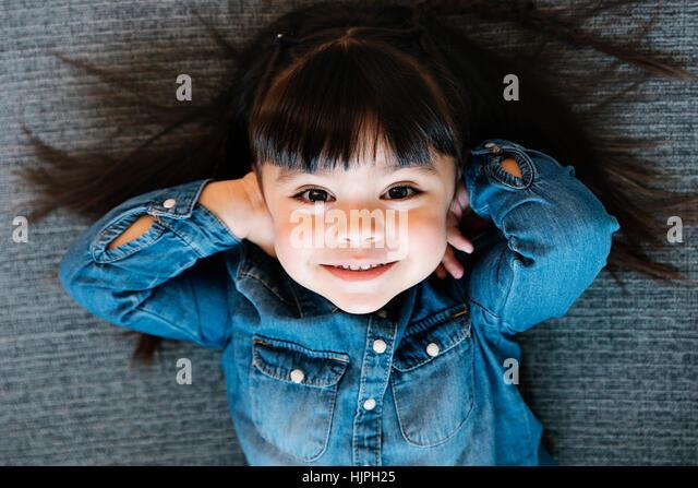 Happy pretty girl looking camera. - Stock Image