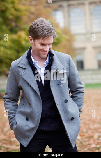 Man in autumn city atmosphere - Stock Image