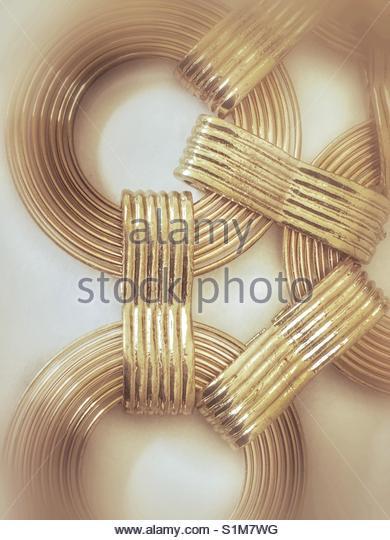 golden Circles (a closeup of a jewellery piece) - Stock Image