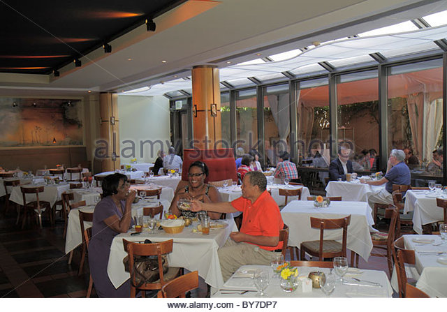 Baltimore Maryland Baltimore Museum of Art Gertrude's Restaurant chef John Shields dining Black man woman table - Stock Image