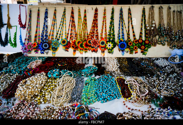 Handmade beaded jewelry sold in the Zocalo in Acapulco, Mexico - Stock Image