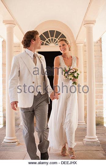 Bride and groom holding hands - Stock-Bilder