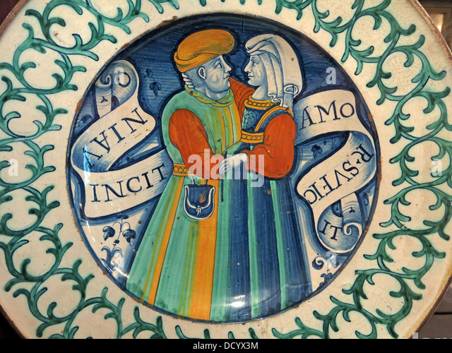 Two lovers eye each other on a dutch plate inscribed 'Love Conquers All' from Waddesdon Manor ,  Aylesbury, - Stock Image