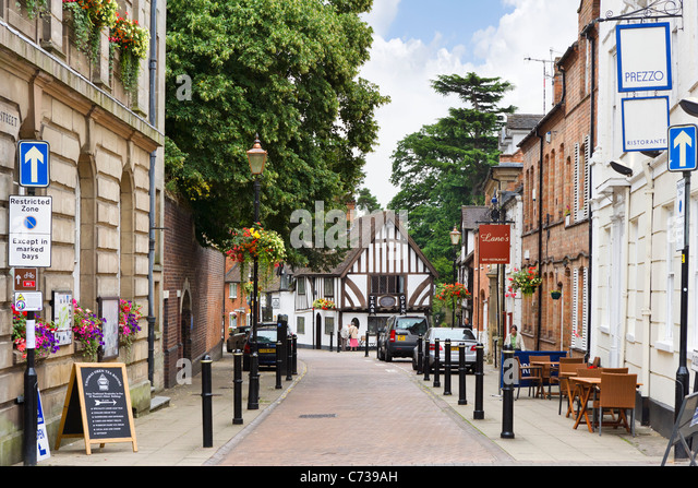 Cafes and restaurants on Castle Street in the old town centre, Warwick, Warwickshire, England, UK - Stock Image