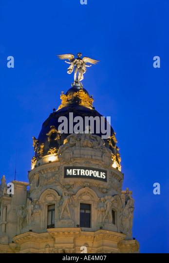Madrid Gran Via Metropolis building angel twilight - Stock Image