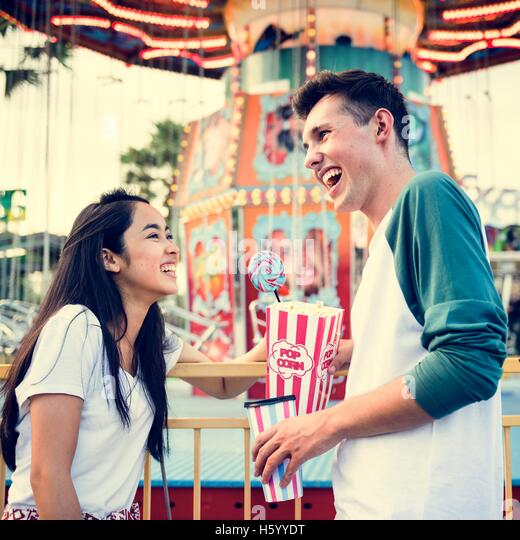 Couple Dating Amusement Park Funfair Festive Playful Happiness Concept - Stock Image
