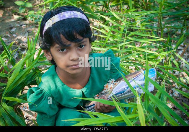 A school kid Jasmine (Flower) Collecting in SSS (Society for Social Service) Center, Tangail, Dhaka, Bangladesh - Stock-Bilder