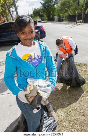 Miami Florida Little Haiti MLK Day of Service EPA Community Day volunteer neighborhood clean-up clean service improvement - Stock Image