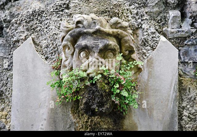 Fountain fugire, demon, grimace, in the garden of the Villa Monastero, museum, Varenna, Lake Como, Lago di Como, - Stock Image