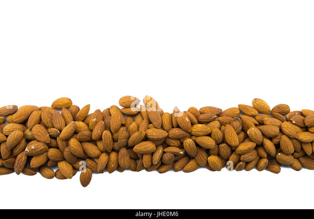 Almonds in Row on Isolated White Background - Stock Image