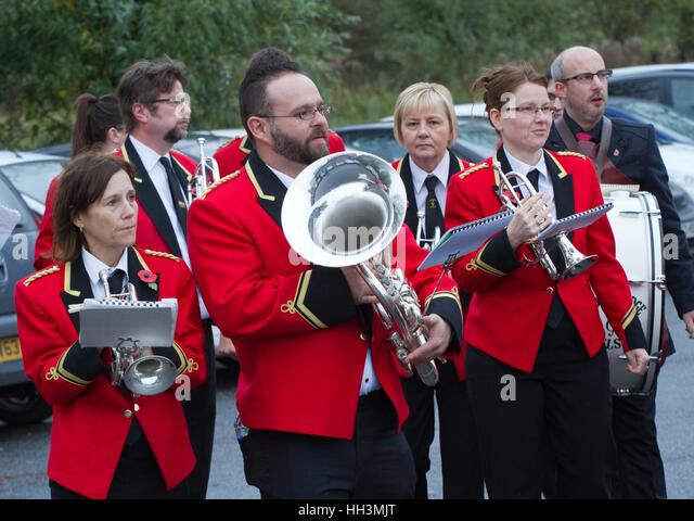 Members of the Woodford Excelsior brass band preparing for a Remembrance Day parade - Stock Image
