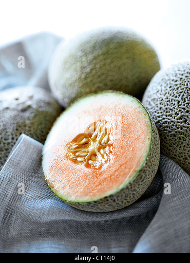 Close up of halved melon - Stock Image