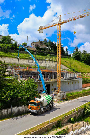 Cement Lorry Delivering Cement Via Long Arm To Site Lessinia Veneto Italy - Stock Image