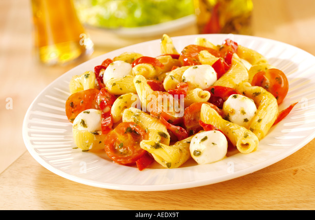 TOMATO MOZZARELLA AND PASTA DISH - Stock Image