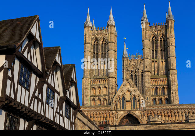 Half-timbered Leigh-Pemberton House and Lincoln Cathedral, from Castle Square, Lincoln, Lincolnshire, England, United - Stock Image