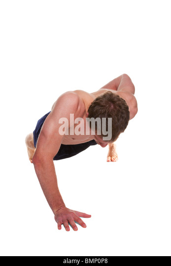 Man doing a one handed push up isolated on a white background - Stock Image