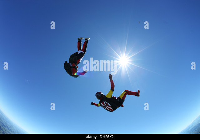 Skydivers upside down above Leutkirch, Bavaria, Germany - Stock Image