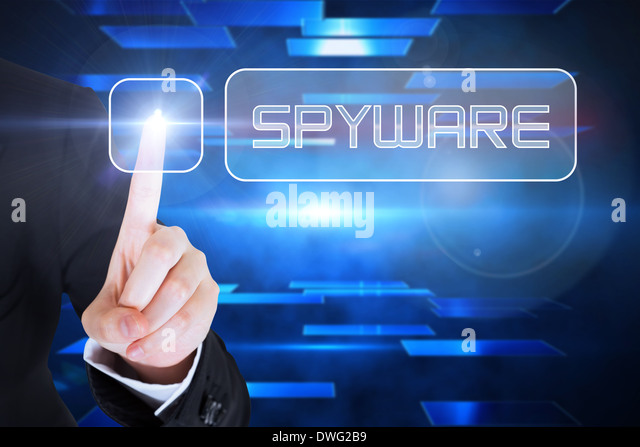 Businesswomans finger touching Spyware button - Stock Image