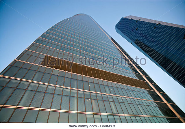 Urban skyscrapers against blue sky - Stock Image