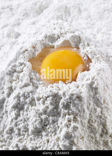 Egg yolk and flour - Stock Image