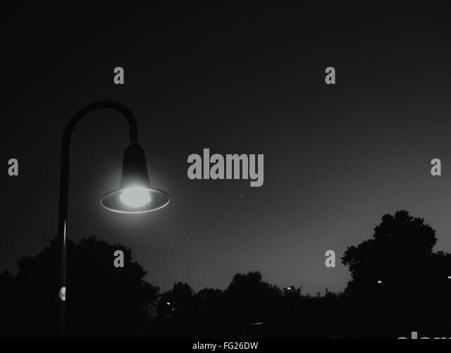 Illuminated Street Light At Night - Stock Image