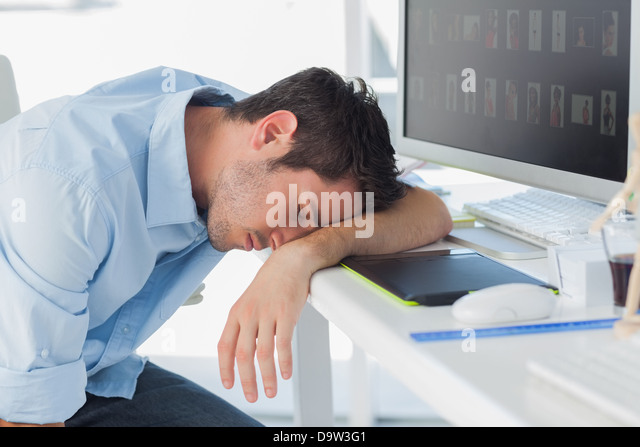 Graphic designer sleeping on the keyboard - Stock-Bilder