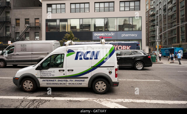 An RCN vehicle parked in New York on Thursday, August 18, 2016. The private-equity firm TPG will buy RCN Telecom - Stock Image
