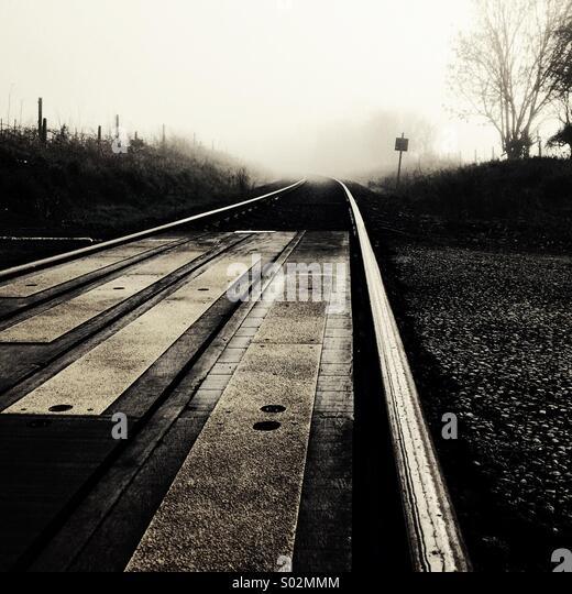 Railway in mist (black & white) - Stock Image
