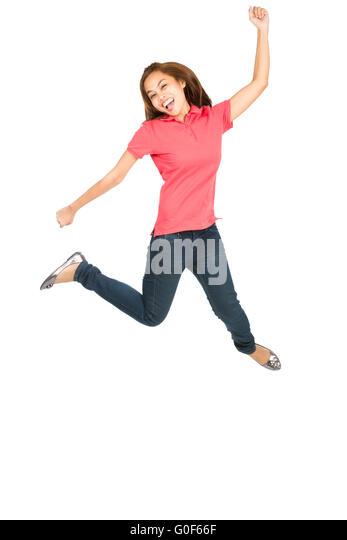 Extreme Celebration Jumping Asian Woman Fist Pump - Stock Image