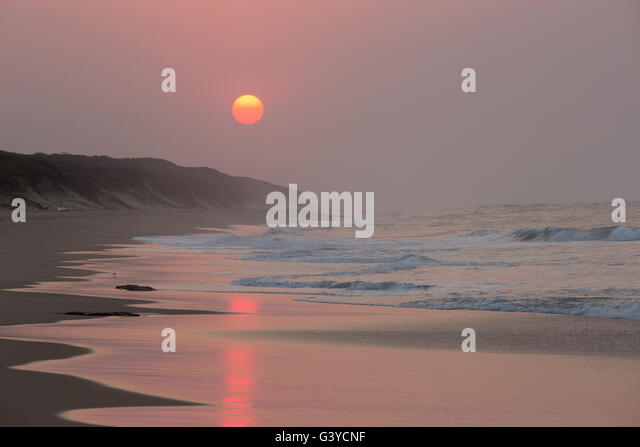 Moody sunrise over the beach in Mozambique - Stock Image