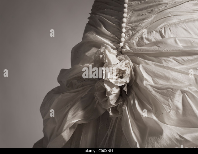 wedding dress by Ian Stuart photographed in the studio - Stock Image