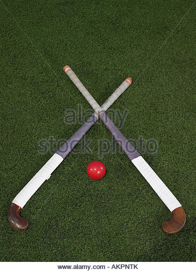 Hockey sticks and a ball - Stock Image