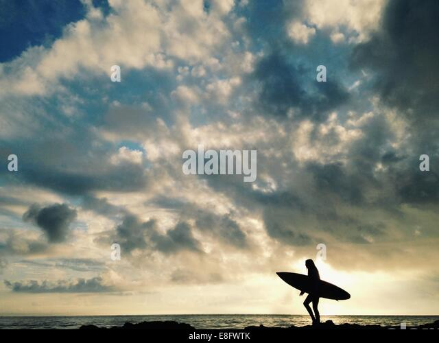 USA, Florida, Duval County, Silhouette of female surfer - Stock Image