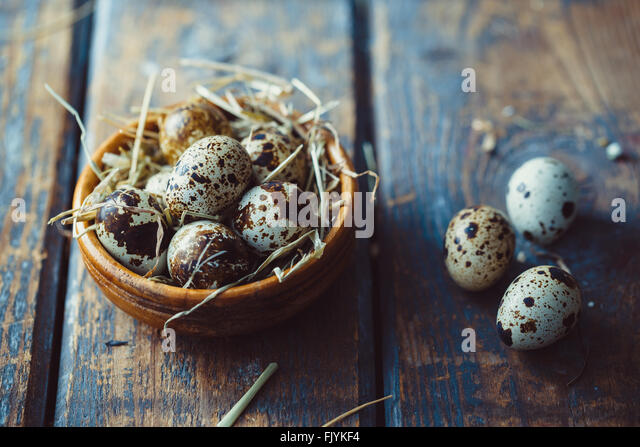 Quail eggs on wooden table - Stock Image
