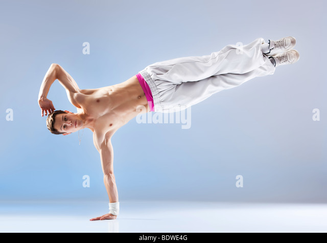 Young man modern dance. On soft white and blue background. - Stock Image