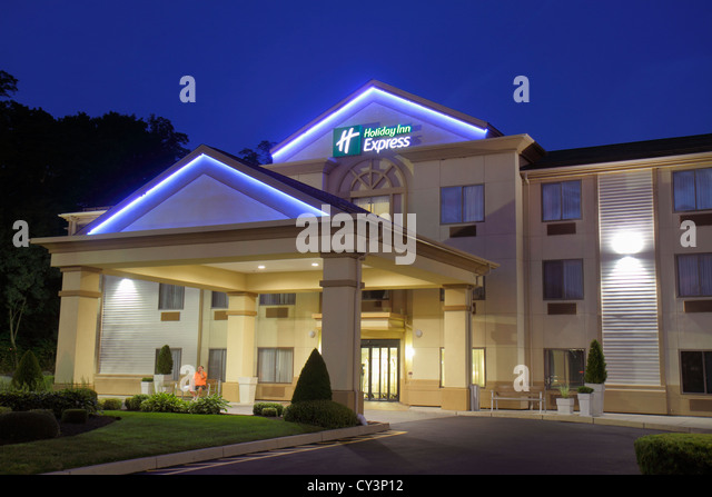 Rhode Island Newport Middletown Holiday Inn Express motel hotel front entrance dusk night - Stock Image