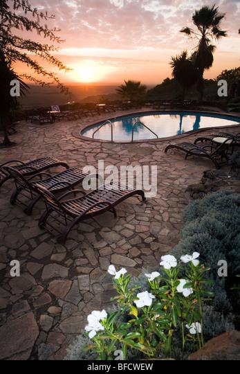 Serena Lodge Pool at Sunrise - Masai Mara National Reserve, Kenya - Stock Image