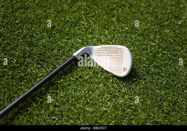 A golf club on grass - Stock Image