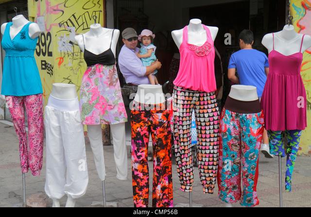 Chile Santiago Barrio Patronato Calle Dardignac shopping business boutique store sidewalk display women's ladies - Stock Image