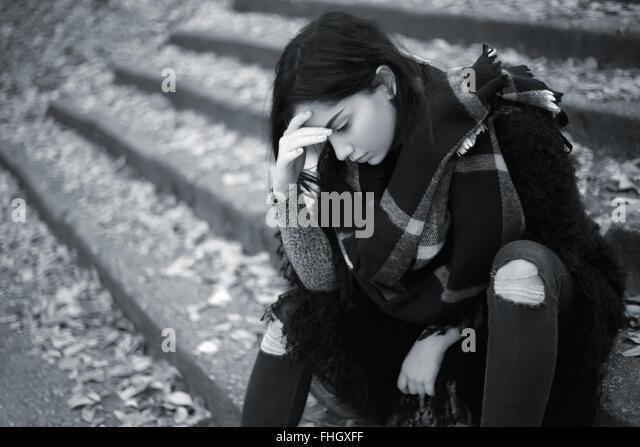 Sad teen girl outdoor feeling depressed - Stock Image