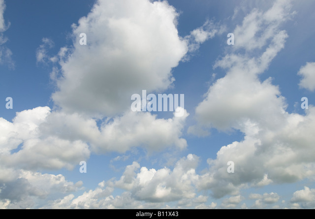 Fluffy white Cumulus clouds, France. - Stock Image
