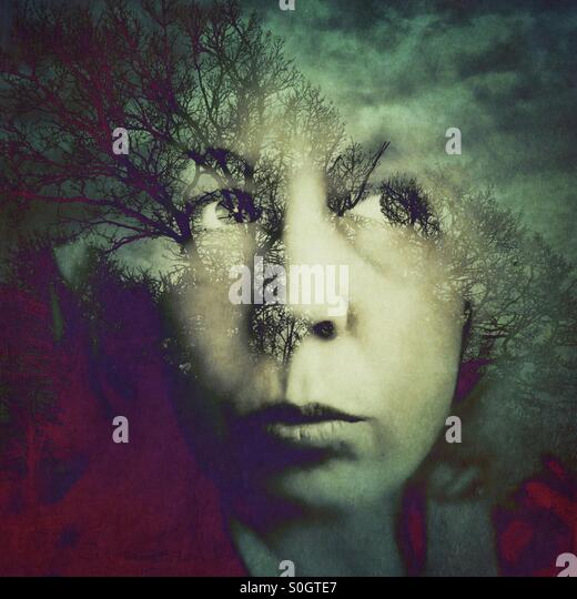Double exposure of woman with trees - Stock Image