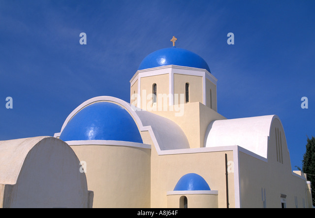 Greece Santorini Church with blue dome and blue sky - Stock Image