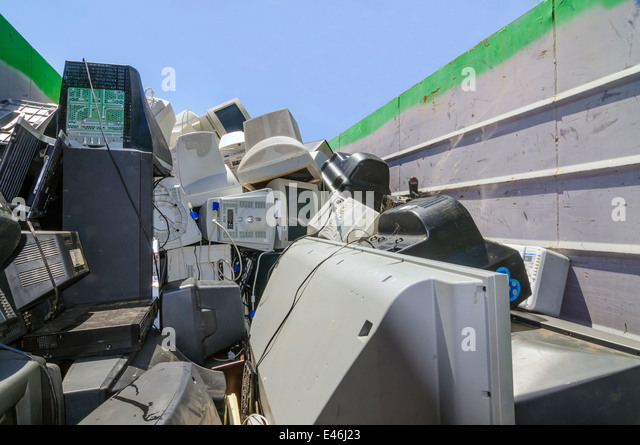 Used computers and other electronics in dumpster at electronic waste collection for community ewaste recycling fundraiser - Stock Image