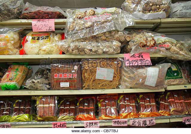 California San Francisco Chinatown ethnic neighborhood Washington Street shopping Oriental grocer dried goods white - Stock Image