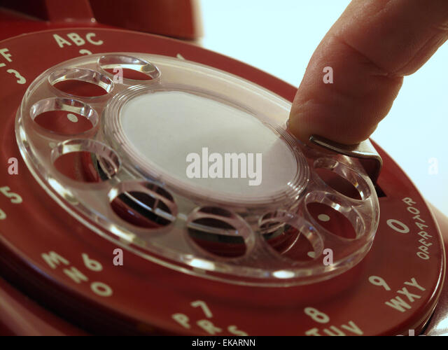 Dialing on a Rotary Telephone - Stock Image