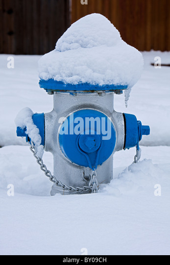 Fire Hydrant In Snow - Stock Image
